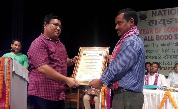 Pramod Bodo ABSU President felicitating one entreprenur during the national seminar